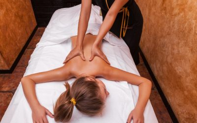 Beautiful young woman white girl having thai massage.